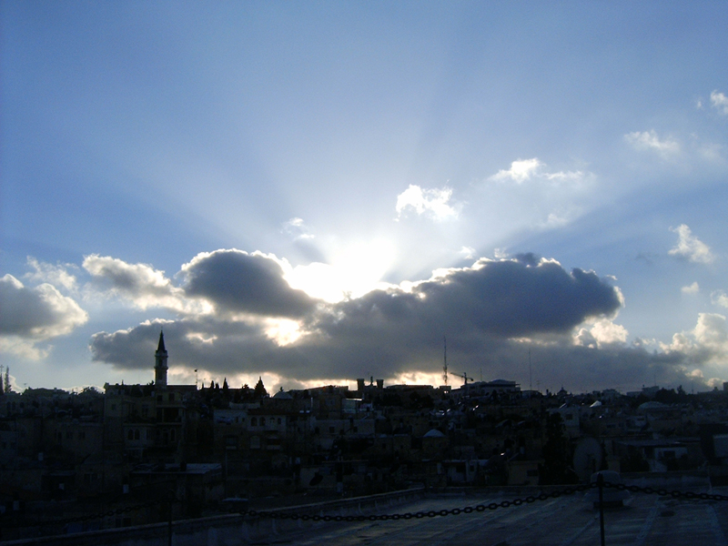 MagPro Photo of the Day:  The Sun Shining Through the Clouds over Jerusalem  From the roof of the Austrian Hospice, located in the Old City, Jerusalem, I witnessed this magnificent view. When our lives get cloudy, with the troubles of this life, we can still focus on the light of God that can shine through any obstruction – if we look hard enough to see it. But it can often be easy to see.   Click on this photo or MagPro Photos to see even more