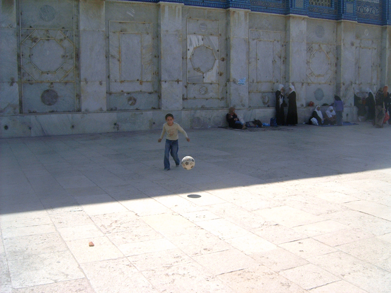 MagPro Photo of the Day: Soccer on the Temple Mount  I had the privilege to play some soccer with a very talented young soccer player, in the area it is thought that Yeshua walked at one time – also not far from the rock where Abraham was going to sacrifice his son, but God stopped him. God later provided his own Son, the 'Lamb of God,' as a sacrifice for the atonement of our sins.   For more photos, please visit MagPro Photos (www.MagPro.org/Photos)