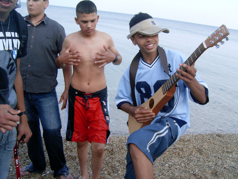 MagPro Photo of the Day: Jamming By the Dead Sea  There's nothing like jamming. Some students from some school from somewhere were watching me perform by the water, and this guy wanted to jam some himself – so I let him borrow my guitar. The one holding his hands with his 10 fingers extended looks pretty cool too. Misop Baynun   For more photos, please visit MagPro Photos (www.MagPro.org/Photos)