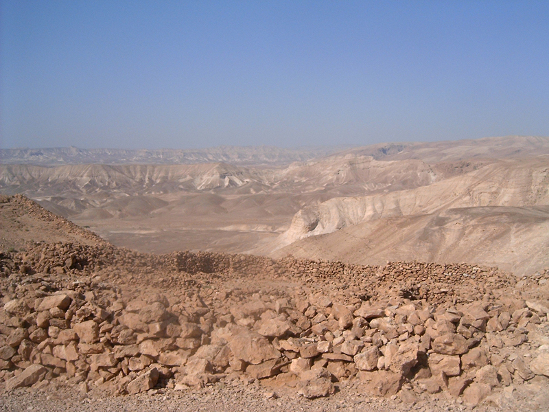 [This is a view of the surrounding area of mountainous desert lands, from mountain next to Masada.]