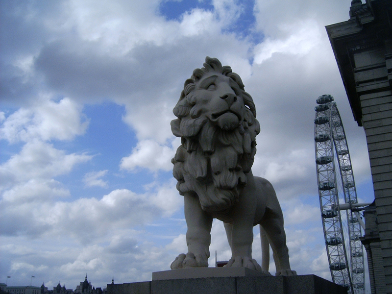 MagPro Photo of the Day: A Reticent Lion Statue in London, England  This Lion Statue, located near the enormous London Eye observation wheel, had quite a reticent austere look to him. At closer look, the Lion looks like he might even cry if he could.  Many adhere to the claim that The London Eye, sometimes called the Millennium Wheel, is the largest observation wheel (a type of Ferris wheel) in the world. Click here for more info about the London Eye  For more photos, please visit MagPro Photos (www.Photos.MagPro.org)